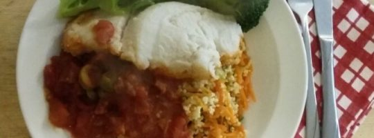 Steamed white fish in tomato sauce with wholewheat couscous and vegetables